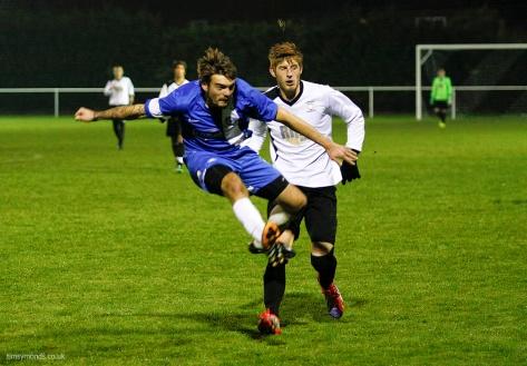 Liam Avey mid-air as he strikes the ball